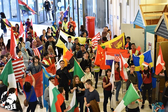 Group with flags of multiple countries in the SU